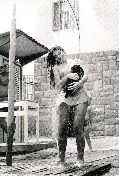 Maria Callas taking a shower with her dog