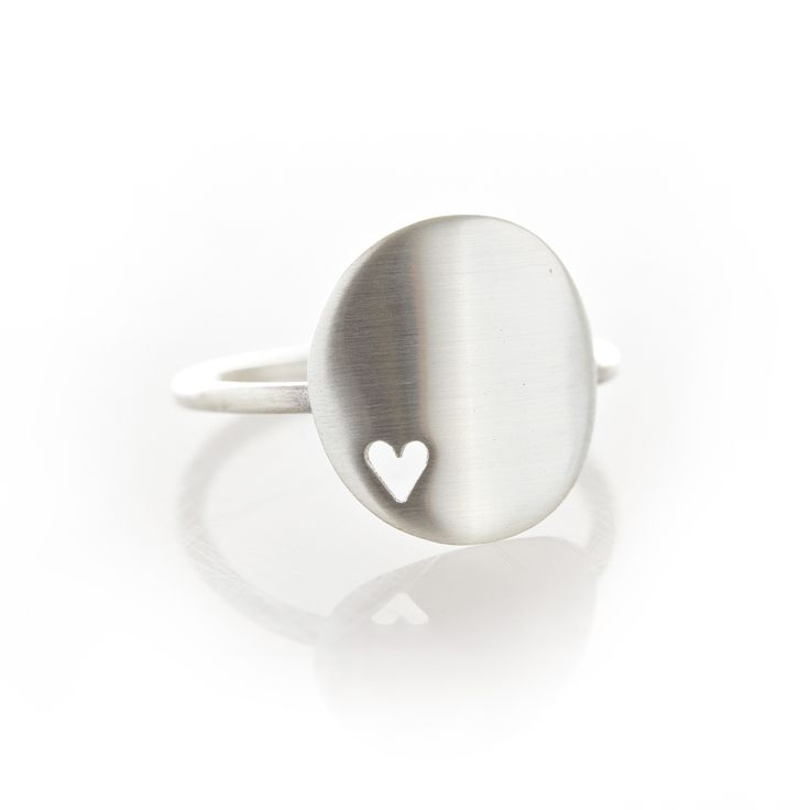 My Favourite... A sterling silver ring with a rounded disc and heart cut out.  Please check our info page for more details on ring sizes.