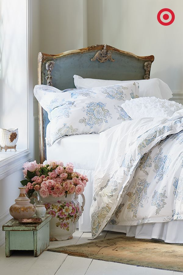 Pure white is always a classic, but why not try mixing it with a cool, light-blue rose pattern for a hint of color? Add a vintage rug, a beautiful bouquet and a distressed vintage stool for an eclectic, Simply Shabby Chic feel in your bedroom.: