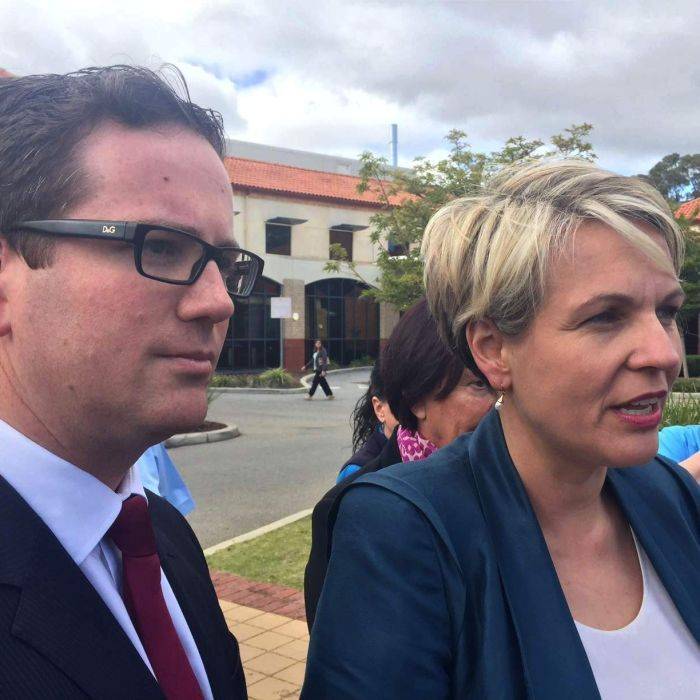 The Liberal candidate in the Canning by-election is trying to distance himself from Prime Minister Tony Abbott, Deputy Labor Leader Tanya Plibersek says.