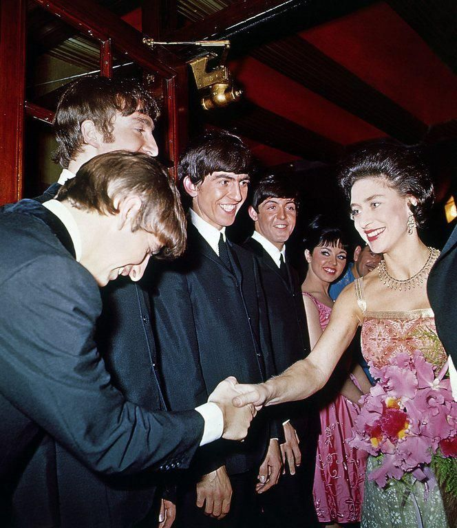The Beatles and Queen Elizabeth II.