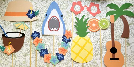 Luau Themed Photo Booth Props  This set includes: 1- Flower Shaped Glasses 1- Shark 1- Orange + Lime 1- Coconut Drink 1- Lei 1- Pineapple 1- Palm Tree 1- Guitar 1- Tourist Hat with Flower   Each prop is printed on cardstock and attached to wooden skewers. All props will be shipped fully assembled and ready to use