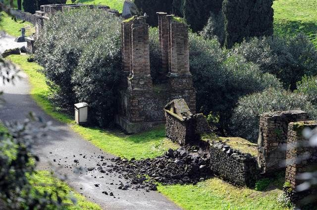 Italy Investigating New Collapses in Ancient Pompeii. The damaged wall of a tomb at the ancient ruins of Pompeii, near Naples, southern Italy. The Temple of Venus and the wall of a tomb in the long-neglected ruins of Pompeii near Naples were found damaged on Sunday, possibly due to heavy rain.