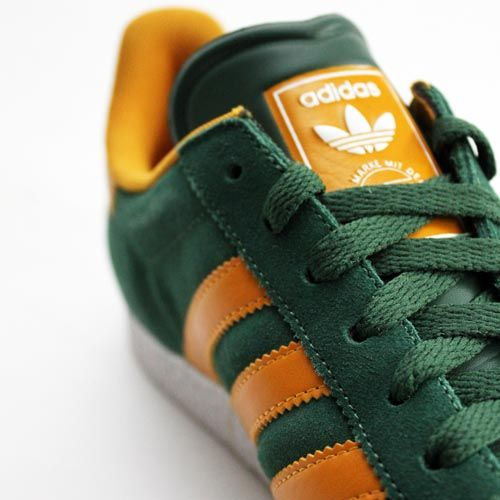 Adidas Gazelle Green with Yellow Stripe.  The classic Adidas Gazelle sneaker was originally released in 1968 and now re-launched as Adidas Gazelle II. Made from soft suede leather upper, vulcanised rubber sole and reinforced toe for a stable fit.
