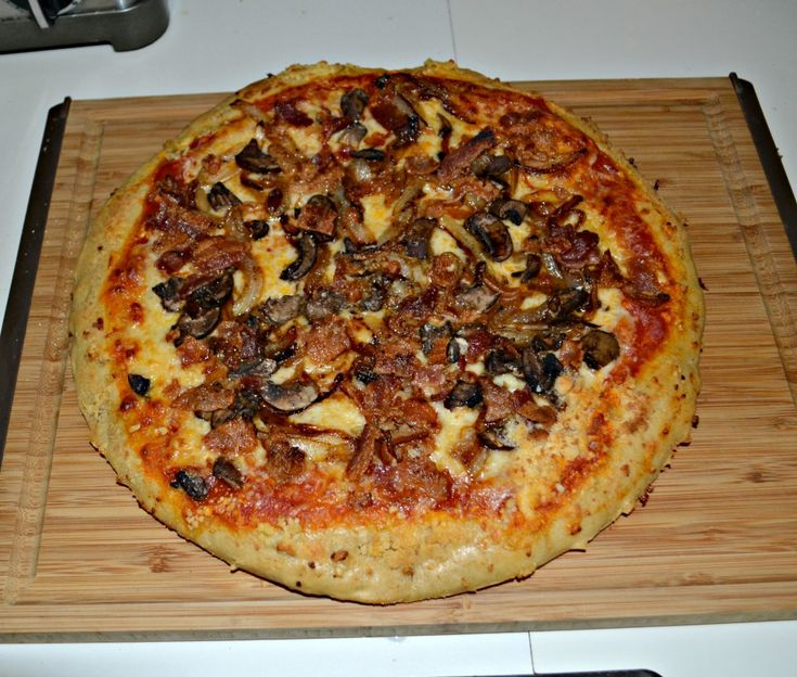 Mellow Mushroom Pizza with mushrooms, bacon, and caramelized onions