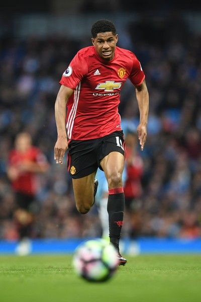 Manchester United's English striker Marcus Rashford chases the ball during the English Premier League football match between Manchester City and Manchester United at the Etihad Stadium in Manchester, north west England, on April 27, 2017. / AFP PHOTO / Paul ELLIS / RESTRICTED TO EDITORIAL USE. No use with unauthorized audio, video, data, fixture lists, club/league logos or 'live' services. Online in-match use limited to 75 images, no video emulation. No use in betting, games or single…