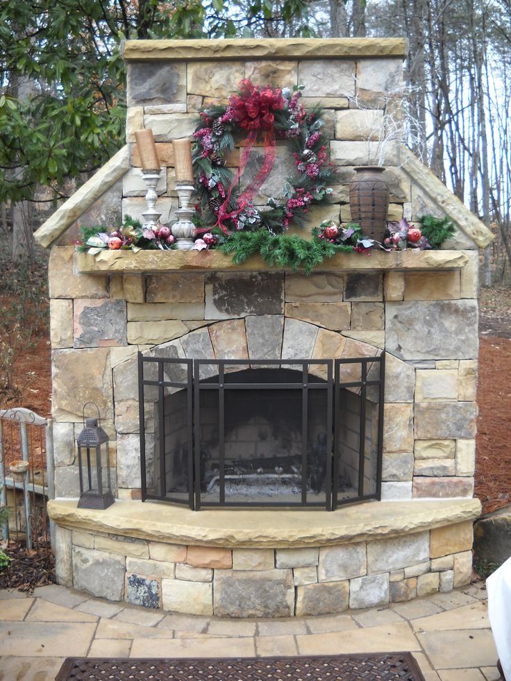 Outdoor stone fireplace adds lovely focal point for outdoor living