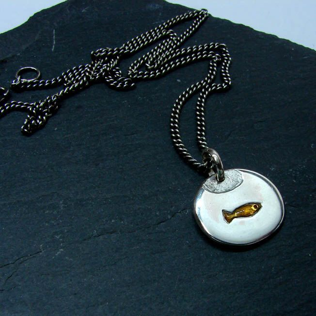 Goldfish in a bowl  pendant, in silver with orange resin by SylvaineJewellery on Etsy https://www.etsy.com/listing/245598669/goldfish-in-a-bowl-pendant-in-silver