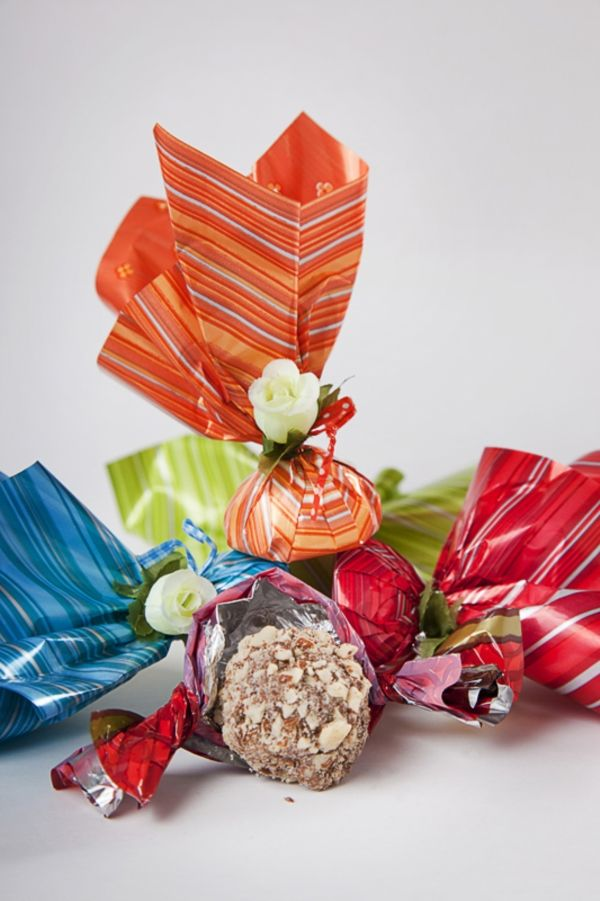Colorful wrappers for a delicious truffle by El Taller del Chocolate. For more ideas and information visit us at www.costaricaparadisewedding.com