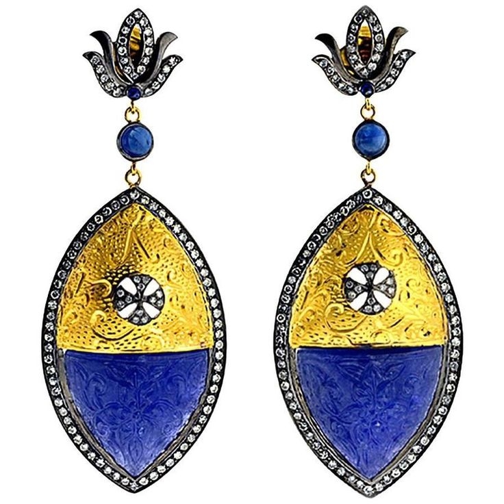 Carved Tanzanite Earring in Gold and Silver with Diamonds | From a unique collection of vintage dangle earrings at https://www.1stdibs.com/jewelry/earrings/dangle-earrings/