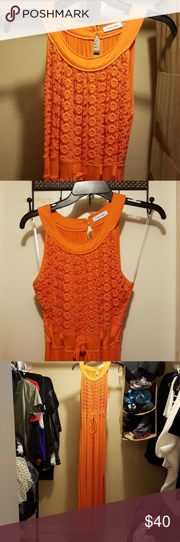 Calvin Klein maxi dress Beautiful Orange maxi dress with knit top and empire waist (makes you look smaller in waist) and tie with gold embellishments and it has pockets! Calvin Klein Dresses Maxi
