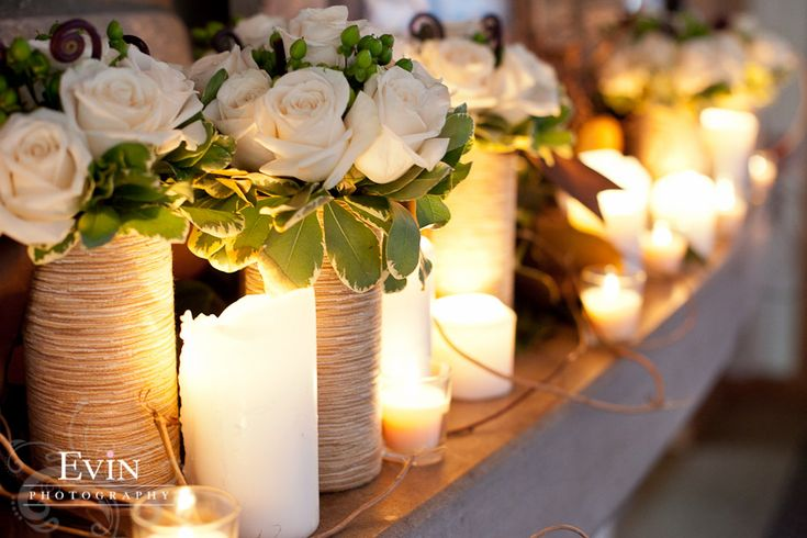 Beautiful candles, twine wrapped vases and white roses