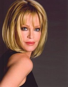 Melanie Griffith -- great female portrait pose.  The great hair doesn't hurt either.