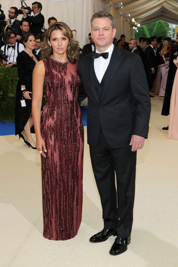 Matt Damon in Versace and Luciana Damon in Atelier Versace at the 2017 Met Gala.  He wore a custom-made, three piece Versace tuxedo and finished his look with white Versace shirt and dress shoes.  She wore a deep ruby red gown with intricate Swarovski crystal details throughout in shades of silver and bronze.