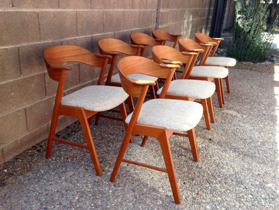 Offering a set of 8 teak dining chairs designed by Kai Kristiansen for KS Mobelfabrik in 1958. The teak frames are in excellent condition and