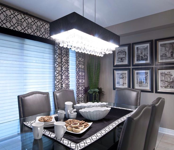 Stunning drapery and accessories for this kitchen make over! The chandelier adds sparkle along with the artwork, silk plant and gorgeous seating this room is the perfect family dinner spot