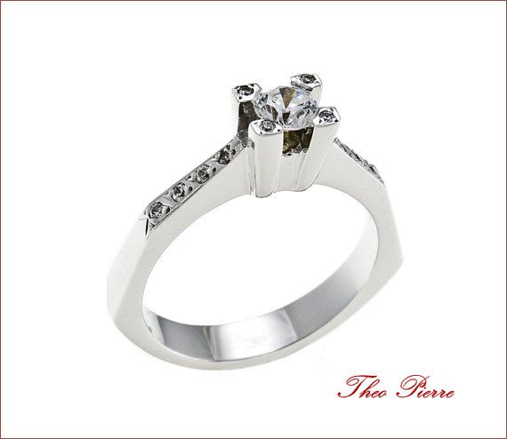 Silver Ring - Solitaire Ring with many Stones in sides and a Single Stone in the middle