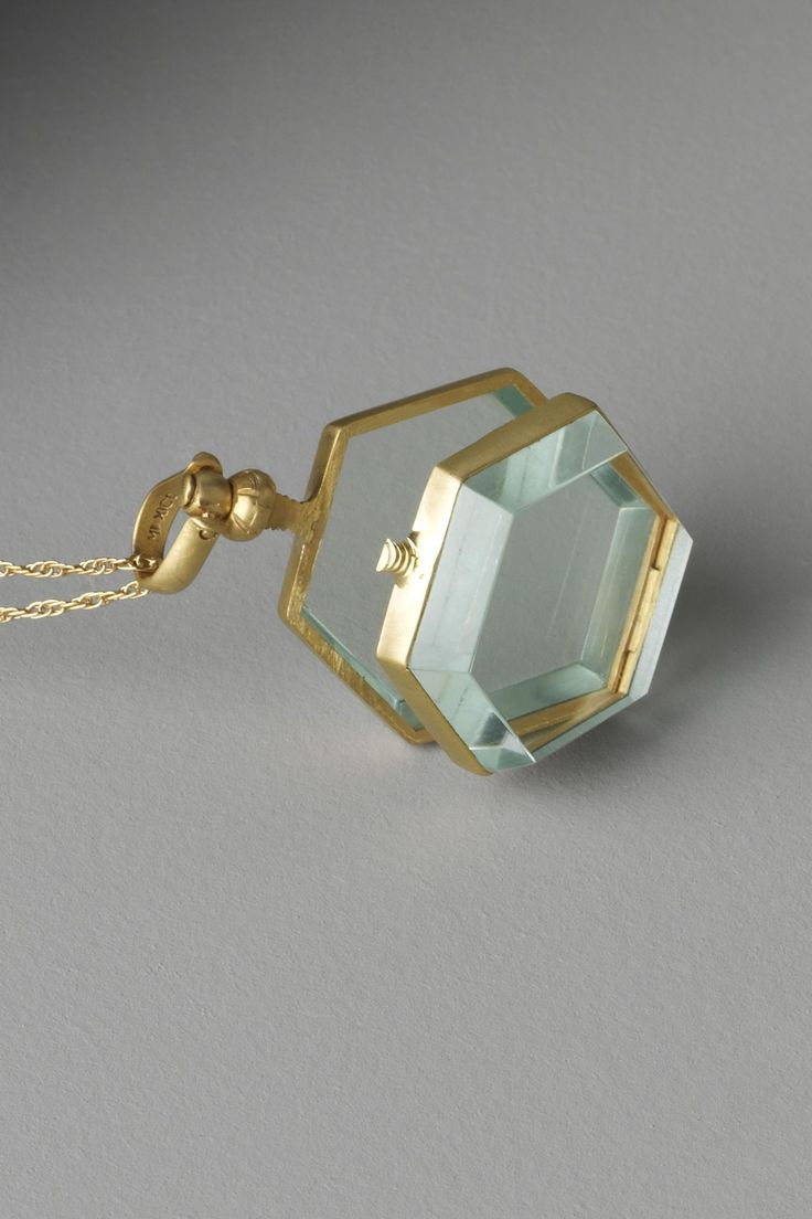 BHLDN (Anthro's new wedding line) necklace. Glass hexagram locket - not exactly hiding a secret, but still with a nice personalized functionality to it