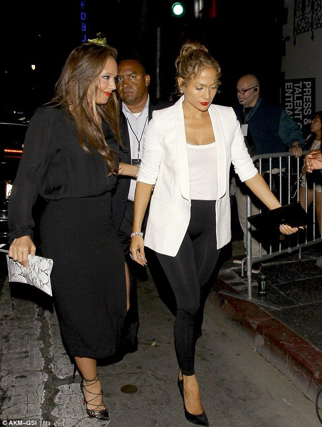 Gal pals: The 44-year-old funnywoman protectively clutched the arm of the 45-year-old pop ...
