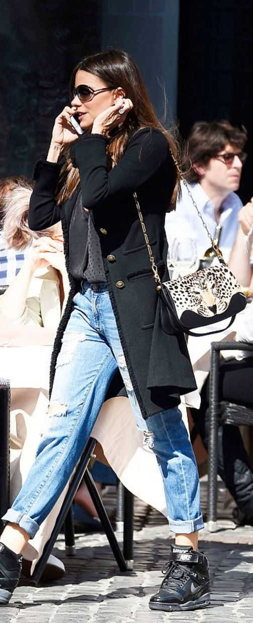 Who made  Sofía Vergara's sunglasses, black coat, and wedge sneakers?