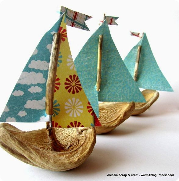 boats made with (found) nut shells of some kind and twigs, plus scrapbooking paper poked over the twigs and glued on top as flags