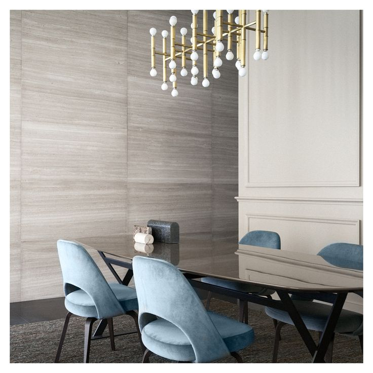 Velvet dusty blue Saarinen dining chairs + Travertine wall. Beige and blue decor.