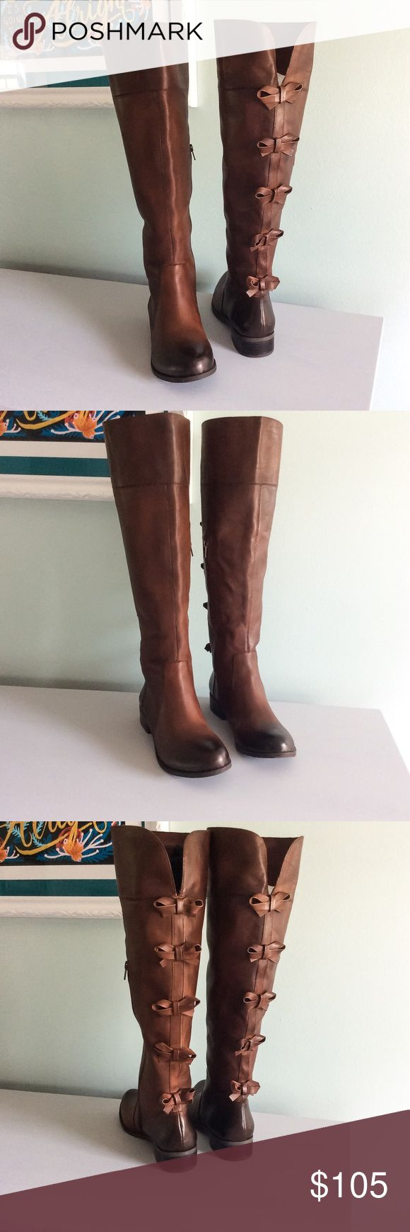 NIB Gianni Bini Cognac Bow Back Riding Boots Sz 9 Brand new in the box (although I cannot find the lid atm) Authentic Gianni Bini Cognac Brown Leather boots with bow back detail. Slight heel, half zip on the inside calf. Super cute! Only parting with these because I have way too many boots. Priced to sell! Gianni Bini Shoes