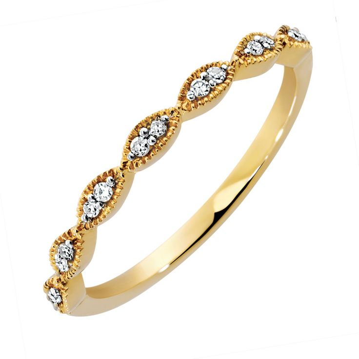 Sparkle elegantly with this diamond and 10ct yellow gold ring. Featuring a collection of round brilliant diamonds set intricately in the gold twist band, this ring is a dainty reflection of femininity.'  Available at Michael Hill.
