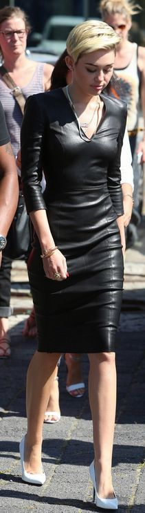 Miley Cyrus wearing a little black pleather dress with v-neck, three-quarter sleeve, knee length, and white pumps.. Get the supplies to make it: http://mjtrends.com/pins.php?name=black-pleather-fabric-for-dress