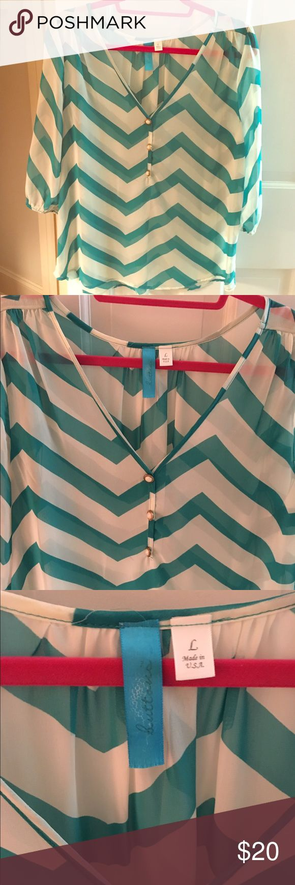 Teal and White Chevron Blouse Teal and white chevron blouse in size large; see-through so a cami underneath is needed. Tops Blouses