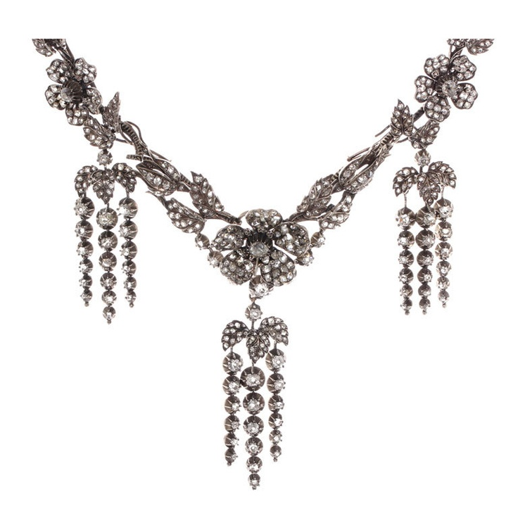 Rare Victorian Garland en Pampille Diamond Necklace and Earrings possibly French in the style of Frederic Boucheron.This piece is done in the naturalist style popular in the time period. All dangling tassels are removable, the two outer convert to earrings and the center portion once converted into a tiara. Old mine cut and rose cut diamonds set in silver and gold.