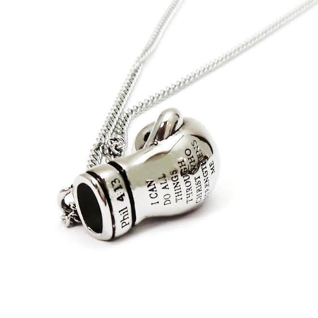 "Shields of Strength - Women's Stainless Steel Boxing Glove Necklace-Phil 4:13 ""PAT"" NO. D758,238, $59.99 (https://www.shieldsofstrength.com/womens-stainless-steel-boxing-glove-necklace-phil-4-13-pat-no-d758-238/)"