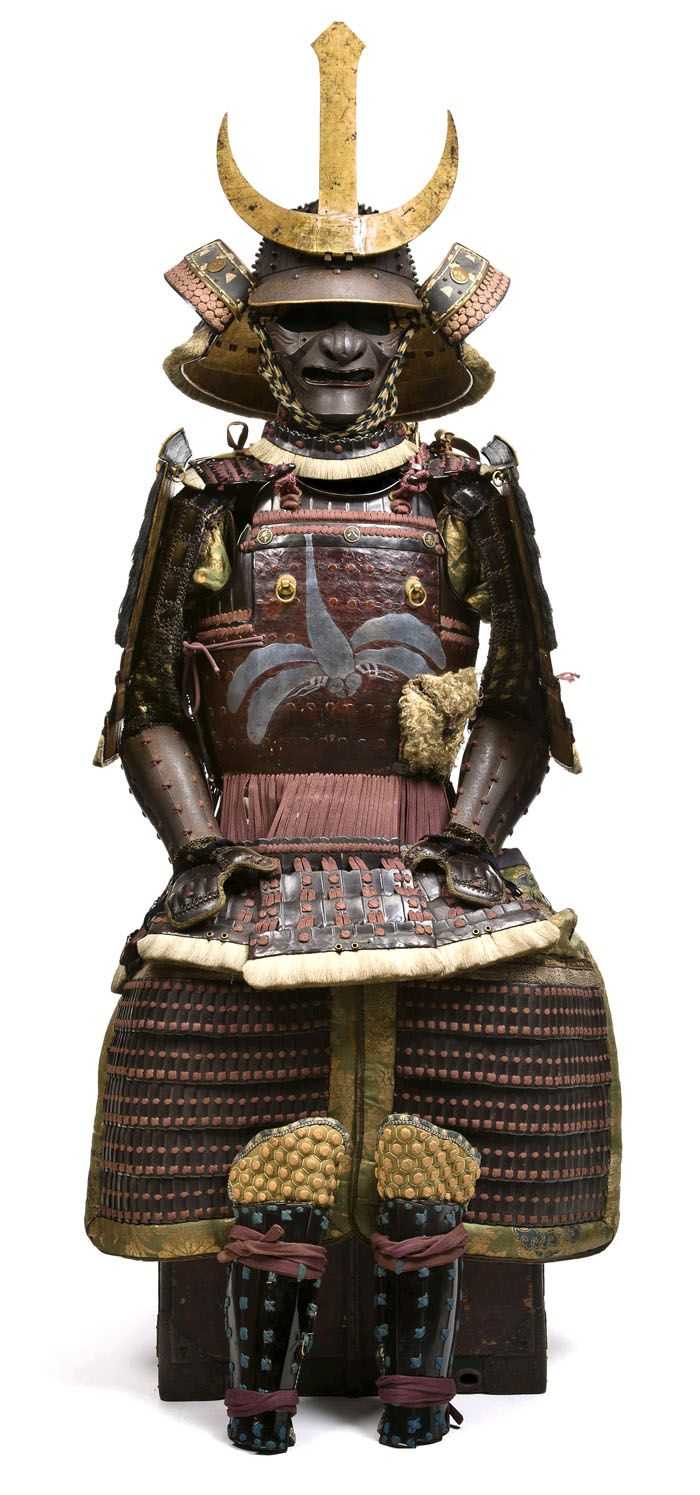 """Gusoku with Ni-mai Okegawa Hishinui Do. Momoyama-Edo period, 17th century Helmet by Iehisa. comprising a good sixteen-plate russet-iron hoshi kabuto with large standing rivets, each with """"star"""" bosses and finished with a four-stage shakudo and gilt-copper tehen kanamono, the mabizashi banded with gilt-copper fukurin carved with floral scroll, the helmet fitted with a three-lame lacquered iron shikoro."""