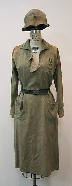 """1935 Girl Scout Uniform.  Label says """"OFFICIAL UNIFORM / GIRL GS SCOUTS / TRADEMARK REG.U.S.PAT.OFF / EQUIPMENT SERVICE / NEW YORK CITY / NAME____""""  c) [cast] """"GIRL SCOUTS / BE PREPARED"""""""
