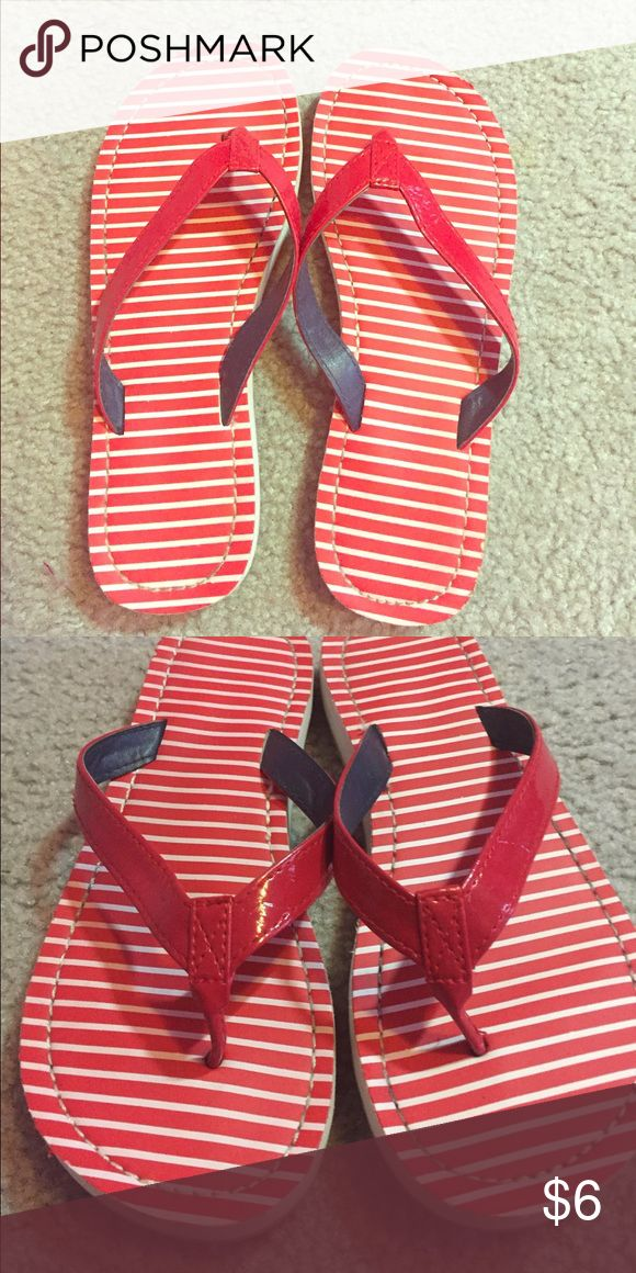 Red Striped Flip Flops 6/7 Red striped flip flops only worn one time size 6/7 Shoes Sandals