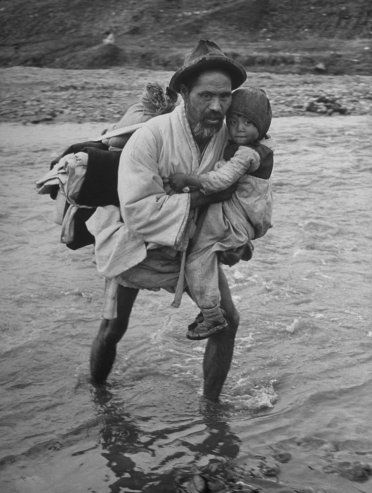 Carl Mydans—Time & Life Pictures/Getty Images Not published in LIFE. Refugees cross into South Korea, March, 1951.