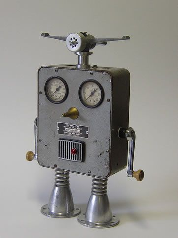 Schauer    Amazing Robot ArtWide-eyed and up for a challenge nothing gets past Schauer. Gloriously displaying his radar headgear (lawn sprinkler) and dual window cranks (arms) this bot is master of all he surveys. A vintage motor analyzer case, auto valve bodies, electric drill parts, springs  and a big gold nose keep him on top of his game.