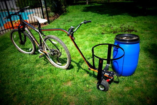 All terrain bike trailer and dolly. Can attach to bike and also haul by hand with the handles. And uses removable barrel that is watertight.