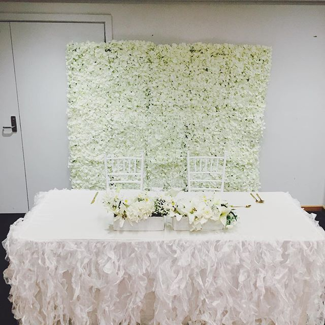 Elegant White Flower Wall Hire for your next event for $100