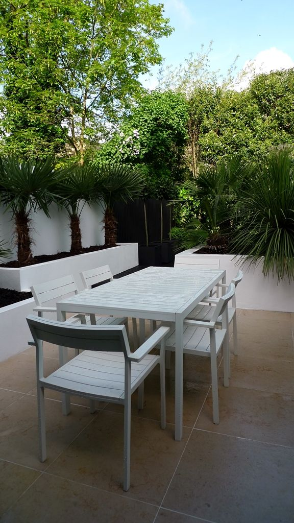 Modern Urban London Garden Design limestone paving white raised beds black decking architectural planting (7)