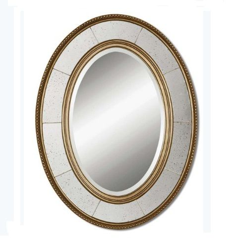 Lara Mirror by Uttermost. This Decorative Mirror Features A Wood Frame With A Lightly Antiqued, Champagne Silver Leaf Finish With Light Gray Glaze. Center Mirror Features A Generous 3.2cm Bevel. The Side Mirrors Are Antiqued. Dimensions:W: 64cm x H:84cm x D: 3cm Weight:9Kg.