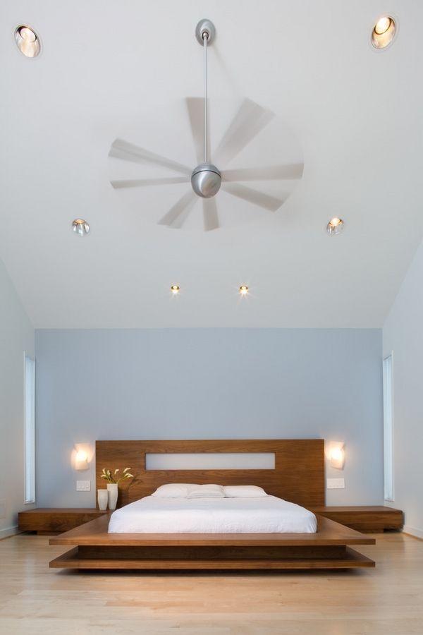 muro bajo cama de plataforma dormitorio minimalista apliques pisos de madera