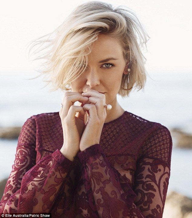 Not married: Lara Bingle has denied she and Sam Worthington have married despite the fact the pair wear matching bands on their ring fingers...