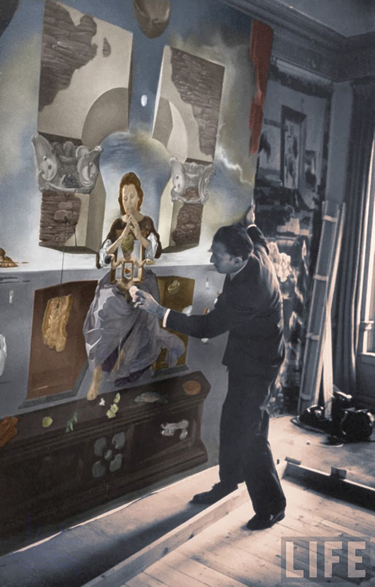 """Salvador Dali (1904–1989) in his art studio #workspace with the second version of his painting """"The Madonna of Port Lligat"""" painted in 1950. Vintage photo by Gisele Freund partially colorized by John Winner. #atelier #arthistory"""