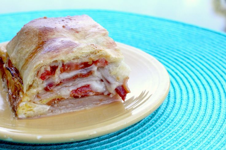 Kentucky Hot Brown Bake - a variation of the famous Kentucky Hot Brown sandwich! Just in time for the Kentucky Derby this weekend. Turkey, bacon, tomatoes, and cheese, all nestled between buttery crescent roll dough!