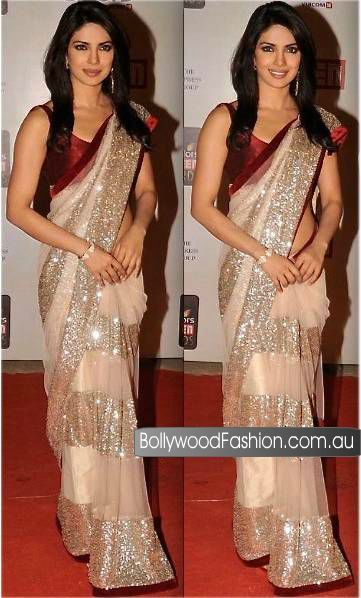 Celebrity Wear Saree in light beige color with maroon combination velvet border exclusively designed for a special occasion. $285.00