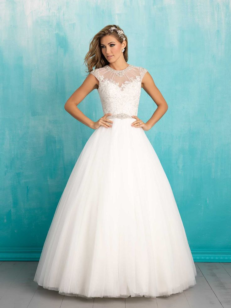 Allure 9301. The sweetness of this tulle ballgown is only heightened by its delicate cap sleeves and lace detailing.