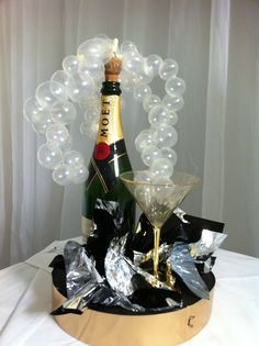 """I am using an empty champagne bottle for a centerpiece for a fundraiser. I have seen pictures of """"bubbles"""" flowing out of the bottle looking like the champagne has fizzed out of bottle. Where can I find something like this? >> Click the image to find out!"""