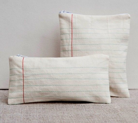 really want to make one of these - imagining that it is linen with a thick style sewing machine stitch with embroidered or sewn-on red ribbon.  Love it!  I'd make pillowcase versions rather than zipper pencil cases.