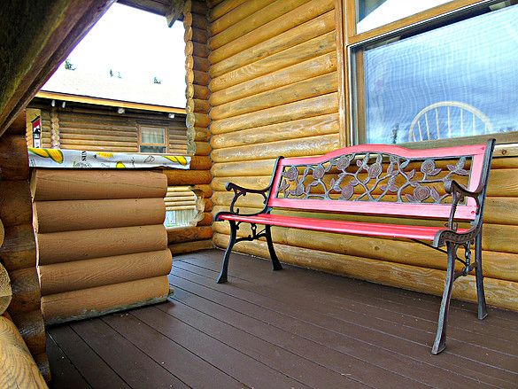 Log Cottage Porch www.cajuncedarlogcottages.com